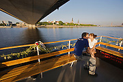River cruise on Daugava river. Young lovers. Old Town in background.