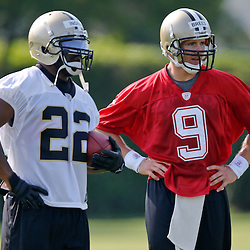 Jul 26, 2013; Metairie, LA, USA; New Orleans Saints quarterback Drew Brees (9) and running back Mark Ingram (22) during the first day of training camp at the team facility. Mandatory Credit: Derick E. Hingle-USA TODAY Sports