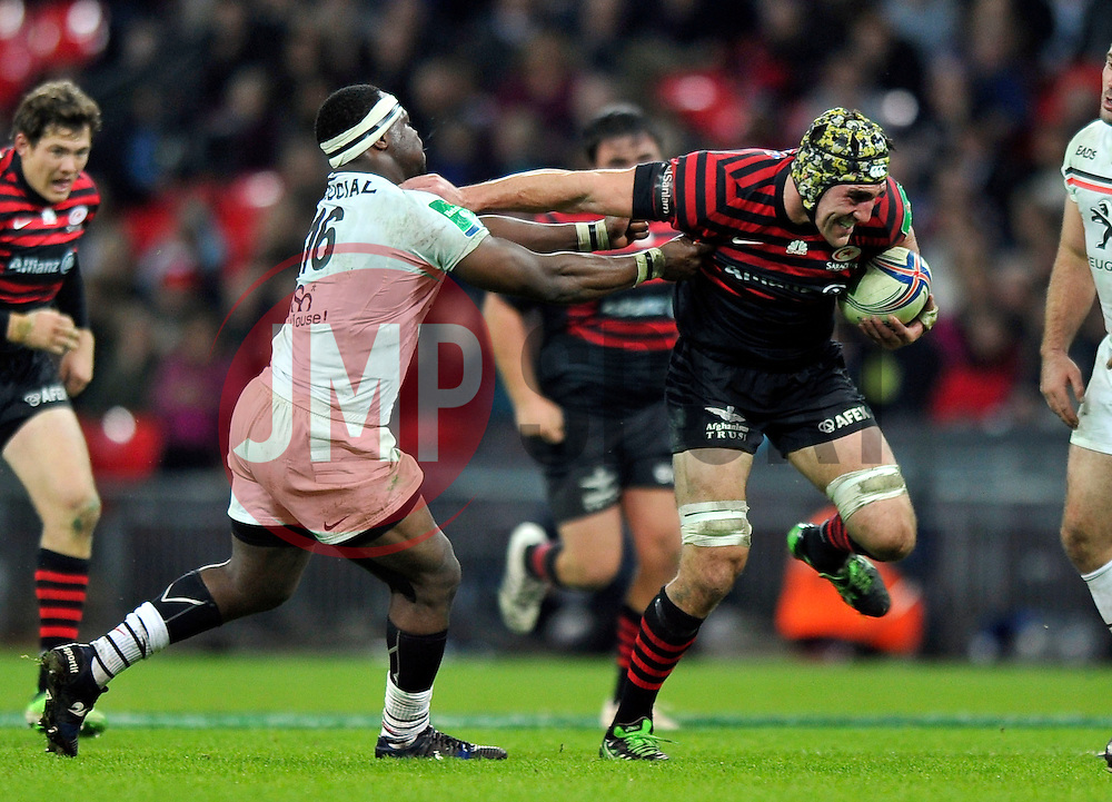 Saracens replacement Kelly Brown hands-off Toulouse replacement Chiliboy Ralepelle - Photo mandatory by-line: Patrick Khachfe/JMP - Tel: 07966 386802 - 18/10/2013 - SPORT - RUGBY UNION - Wembley Stadium, London - Saracens v Toulouse - Heineken Cup Round 2.