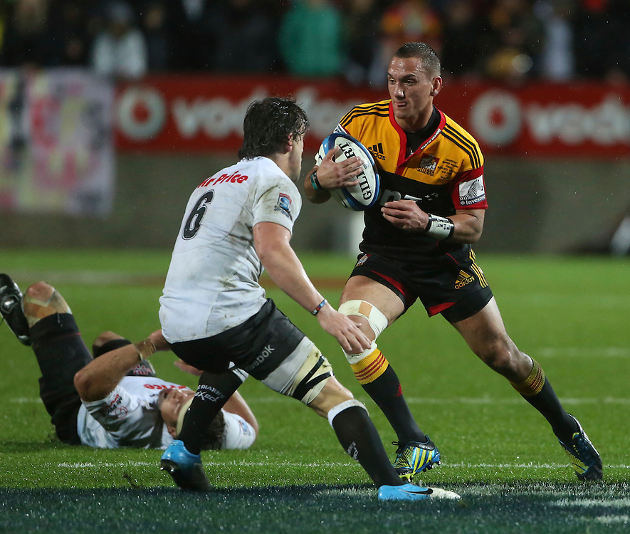 Chief's Aaron Cruden, right, looks to beat  the Shark's Keegan Daniel in the Super 15 Rugby final match, Waikato Stadium, New Zealand, Saturday, August 04, 2012. Credit:SNPA / John Cowpland