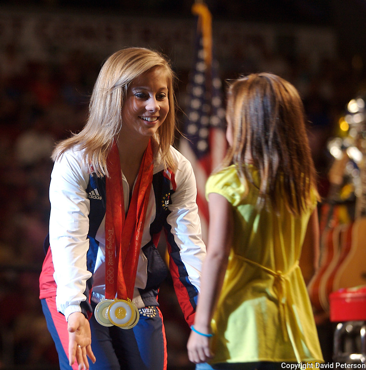 """Olympian Shawn greets an aspiring young gymnast at her homecoming celebration August 26 in Des Moines, Iowa.  Johnson's homecoming was attended by over 7,000 fans who filled the Wells Fargo Arena in Des Moines.  Johnson showed off her four Olympic medals, including a gold for the balance beam.  The city of Des Moines declared the month of September """"Shawn Johnson Month"""".  As one of the most recognizable faces of the Beijing Olympics, Johnson has been on a whirlwind post Olympics tour, which has included an appearance on The David Letterman Show.  She will also appear on Jay Leno, and will lead the Pledge of Allegiance at this year's Democratic Convention."""