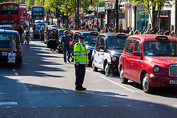 London, April 21st 2015. Hundreds of London black taxi operators bring traffic to a standstill as they protest on Oxford Street against what they say is Transport For London's failure to enforce their own regulations, allowing illegal minicabs to operate putting the public at risk and taking potential earnings from licenced operators.