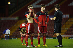 The Referee has a word with Bristol City U18s Pierce Mitchell and Lewis Hall during the first half of the match - Photo mandatory by-line: Rogan Thomson/JMP - Tel: Mobile: 07966 386802 - 04/12/2012 - SPORT - FOOTBALL - Ashton Gate Stadium - Bristol. Bristol City U18 v Ipswich Town U18 - FA Youth Cup Third Round Proper.