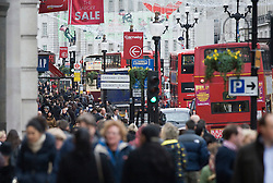 © Licensed to London News Pictures. 23/12/2011. London, UK. Shoppers on Oxford Street, London on December 23, 2011 . £1 million GBP is expected to be spent every minute on what is the busiest shopping day of the year. Photo credit: Ben Cawthra/LNP