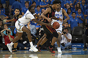 Nov 15, 2019; Los Angeles, CA, USA;  UNLV Rebels guard Bryce Hamilton (13) is defended by UCLA Bruins guard Prince Ali (23) in the second half at Pauley Pavilion. UCLA defeated UNLV 71-54.