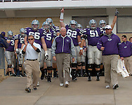 Kansas State head coach Bill Snyder (C) leads his Wildcats out of the locker room before their game with Missouri at Bill Snyder Family Stadium in Manhattan, Kansas, November 19, 2005.  K-State defeated the Missouri Tigers 36-28.