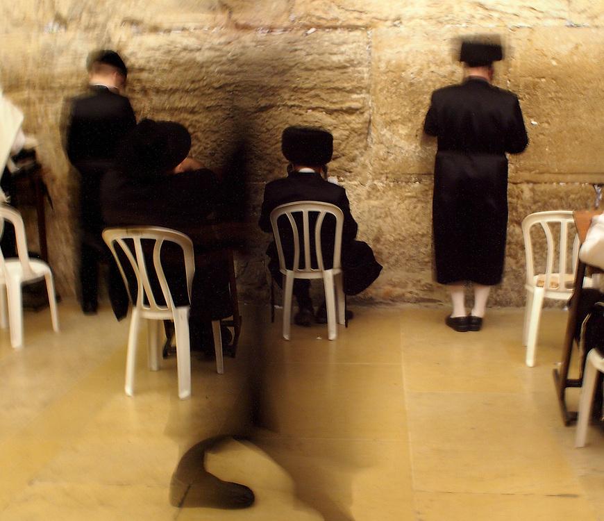 Orthodox Jewish men praying in the Kotel in the Old City of Jerusalem, 2013.