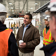 December 12, 2016 - New York, NY :  New York State Governor Andrew M. Cuomo, in brown jacket at center, greets workers as he enters the 96th Street Second Avenue subway station on Monday morning. After years of delays, the new second avenue subway line is nearing completion. The governor visited the soon-to-open second avenue subway project on Monday morning with this photographer and New York Times reporter Emma G. Fitzsimmons.  CREDIT: Karsten Moran for The New York Times