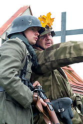 Re-enactors portrayiing a German Infantry from the 276th Volksgrenadier Division during a battle battle re-enactment in on Pickering Showground<br /> <br /> 17/18 October 2015<br />  Image &copy; Paul David Drabble <br />  www.pauldaviddrabble.co.uk