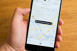 Uber taxi booking app showing Berlin, Germany on iPhone 6 smart phone