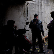 DONETSK, UKRAINE - OCTOBER 18, 2014: IDPs at a bomb shelter in Petrovskiy district of Donetsk socialize outside the shelter during a pause in the fighting between DNR separatist combatants and the Ukrainian National Guard for the control of Donetsk city. More than one hundred people have been living for the past four months at the shelter. CREDIT: Paulo Nunes dos Santos