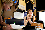 GOP Presidential candidate Rep. Michele Bachmann waits for a conference call with House Speaker John Boehner while on her campaign bus in Muscatine, Iowa, July 24, 2011.