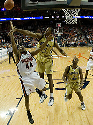 Georgia Tech Yellow Jackets Forward Brad Sheehan (34) blocks a shot from Virginia Cavaliers point guard Sean Singletary (44).  The Virginia Cavaliers Men's Basketball Team defeated the Georgia Tech Yellow Jackets 75-69 at the John Paul Jones Arena in Charlottesville, VA on February 24, 2007.