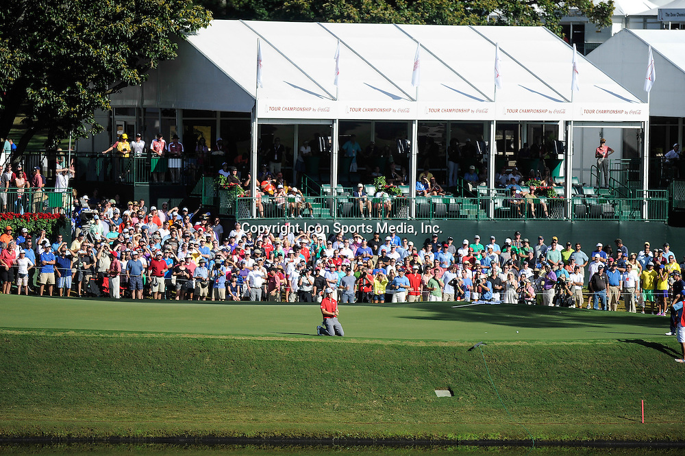 22 September, 2013:  Jordan Spieth drops to his knees on 17 as he drops a stroke to  Henrik Stenson during the final round of the FedEx Cup - The Tour Championship at East Lake Golf Club in Atlanta, Georgia.