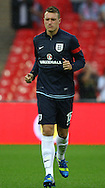 Picture by John Rainford/Focus Images Ltd +44 7506 538356<br /> 14/08/2013<br /> Phil Jones of England warms up before the International Friendly match at Wembley Stadium, London.