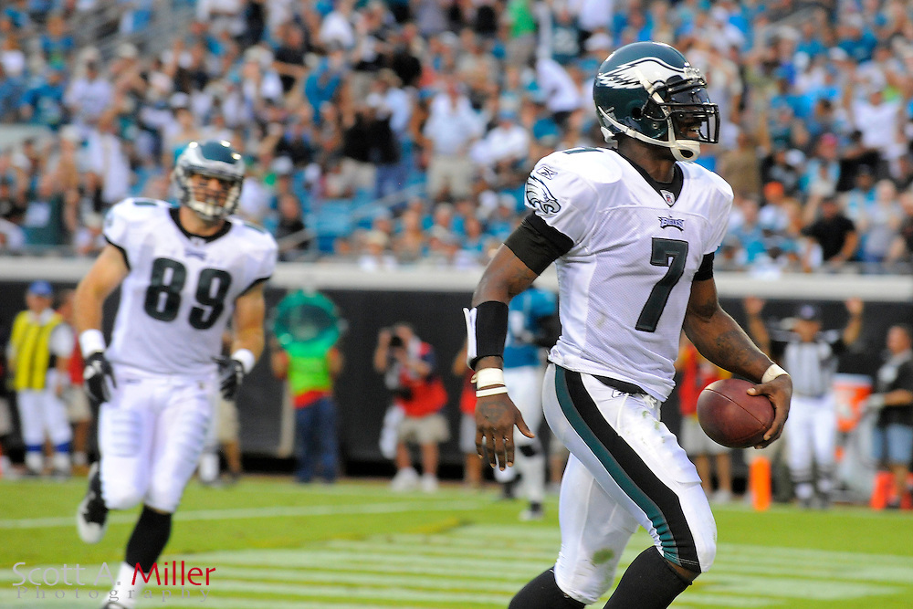 Sept. 26, 2010; Jacksonville, FL, USA;Philadelphia Eagles quarterback Michael Vick (7) runs for a second-half touchdown in his team's game against the Jacksonville Jaguars at EverBank Field. ©2010 Scott A. Miller