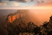I photographed this scene of the Grand Canyon at sunset on the last day of the first 100 years of the National Park Service. About 30 minutes before sunset a thunderstorm built-up west of here near the Grand Canyon Lodge, the only storm over the canyon that evening, and slowly moved east towards Cape Royal. The timing couldn't have been more perfect as the storm opened up and the rain fell into the valley west of Wotans Throne as the sun was setting. I can't think of a better way to celebrate the end of the first 100 years of our National Parks.