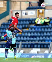 Derrick Williams of Bristol City beats Adebayo Akinfenwa of Wycombe Wanderers to a header - Mandatory by-line: Robbie Stephenson/JMP - 09/08/2016 - FOOTBALL - Adams Park - High Wycombe, England - Wycombe Wanderers v Bristol City - EFL League Cup
