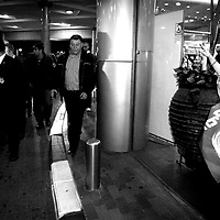 Israeli Likud party leader Benjamin Netanyahu going out of Azrieli shopping center in Tel Aviv after speaking to people on the elections day, February 2009.