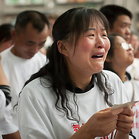 A mother grieves while clutching a photograph of her dead child during a memorial ceremony at Xinjian Primary School, which collapsed during the May 12th earthquake in Dujiangyan city, Sichuan province on June 1, 2008. Over 200 children died in this collapse that is being blamed on shoddy construction. The Chinese government estimated that 5,335 children died in the quake, the majority in schools that collapsed, Reuters estimated it to be closer to 9,000.