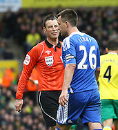 Picture by Paul Chesterton/Focus Images Ltd.  07904 640267.21/01/12.Referee Mark Clattenburg and Chelsea's John Terry discuss matters during the Barclays Premier League match at Carrow Road Stadium, Norwich.