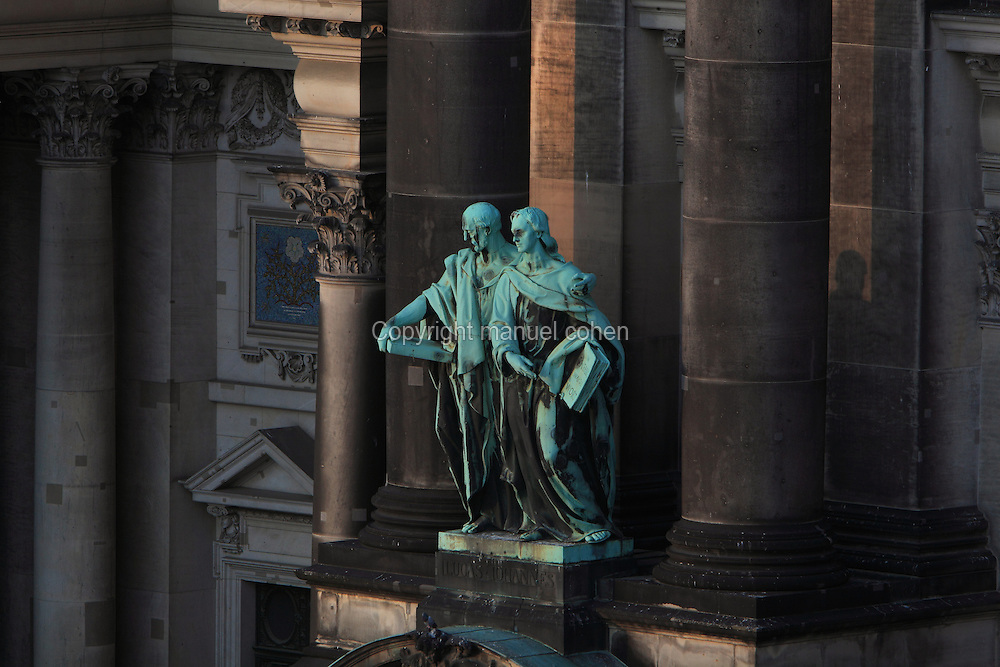 Statue of the evangelists Luke and John on the facade of the Berliner Dom or Berlin Cathedral, redesigned by Julius Raschdorff and completed 1905 in Historicist style after being badly damaged in World War Two, although the original chapel on this site was consecrated in 1454, Museum Island, Mitte, Berlin, Germany. The buildings on Museum Island were listed as a UNESCO World Heritage Site in 1999. Picture by Manuel Cohen