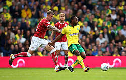 Cameron Jerome of Norwich City passes the ball away from Aden Flint of Bristol City - Mandatory by-line: Robbie Stephenson/JMP - 23/09/2017 - FOOTBALL - Carrow Road - Norwich, England - Norwich City v Bristol City - Sky Bet Championship
