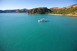 Tourist charter boat MV Odyssey anchors near Naturalist Island at the mouth of the Hunter River on the Kimberley coast.