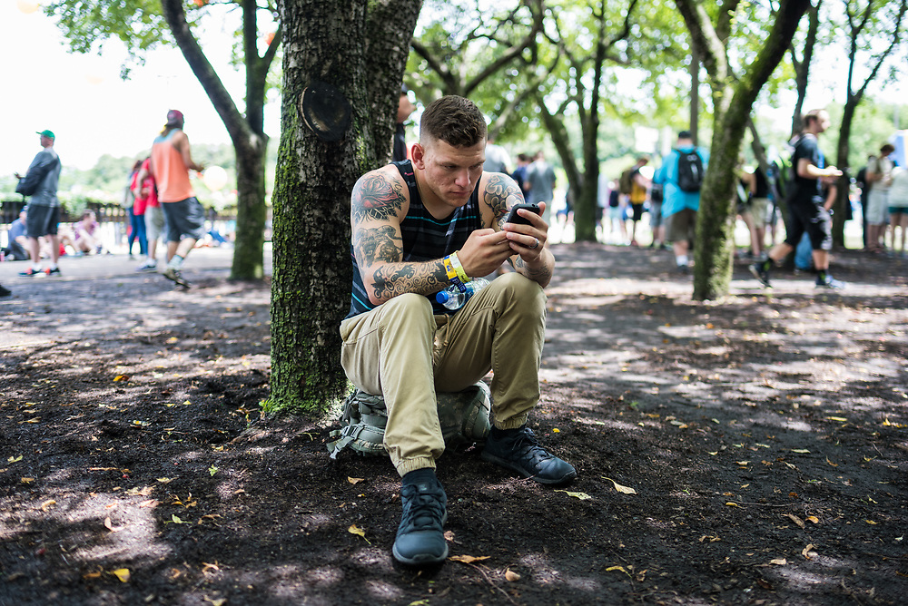 Shane Galton, a solider stationed at Fort Knox in Kentucky, plays Pokémon GO in Grant Park at Pokémon GO Fest on July 22, 2017.