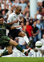 Fotball<br /> Premier League 2004/05<br /> Tottenham v Norwich<br /> White Hart Lane<br /> 12. september 2004<br /> Foto: Digitalsport<br /> NORWAY ONLY<br /> Frederic Kanoute<br />Tottenham Hotspur <br /> <br />Marc Edworthy Norwich City