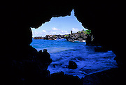 View of black sand beach area from small cave - Waianapanapa State Park, Maui, Hawaii.