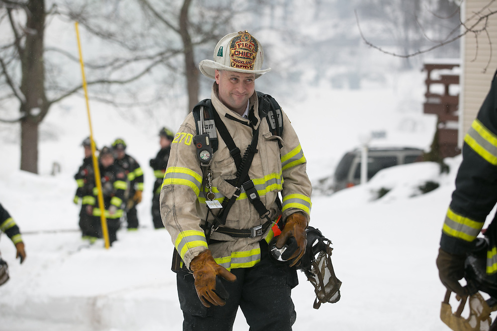 Hingham, MA 02/11/2013.Rockland Fire Chief Scott Duffey at the scene of a 3 alarm house fire at 276 East St. in Hingham on Monday, February 11..Alex Jones / www.alexjonesphoto.com