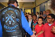 Members of the Thin Blue Line Foundation and Law Enforcement Motorcycle Club are greeted by Stevens ES students.
