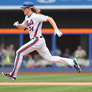 NEW YORK, NEW YORK - July 03: Pitcher Noah Syndergaard #34 of the New York Mets runs to second after hitting a double during the Chicago Cubs Vs New York Mets regular season MLB game at Citi Field on July 03, 2016 in New York City. (Photo by Tim Clayton/Corbis via Getty Images)
