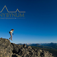 girl hiker jumping across sharp rocks, montana, badger two medicine area,  montana, russel country, montana, usa, russell