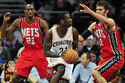 March 23, 2010; Cleveland, OH, USA; Cleveland Cavaliers power forward J.J. Hickson (21) is double teamed by New Jersey Nets small forward Travis Outlaw (21) and center Brook Lopez (11) at Quicken Loans Arena. The Nets beat the Cavaliers 98-94 in overtime. Mandatory Credit: Jason Miller-US PRESSWIRE