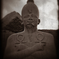 A black and white creative photograph of a statue of the New Kingdom Pharaoh Thutmes III. Built circa 1400 BC. Karnak Temple, Egypt.