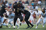 Khalil Banks (4) of The Colony breaks free against Frisco Heritage during a high school football game at Tommy Briggs Cougar Stadium in The Colony, Texas on September 11, 2015. (Cooper Neill/Special Contributor)
