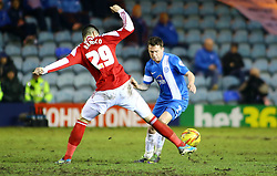 Peterborough United's Danny Swanson in action with Swindon Town's Raphael Rossi Branco - Photo mandatory by-line: Joe Dent/JMP - Tel: Mobile: 07966 386802 05/02/2014 - SPORT - FOOTBALL - Peterborough - London Road Stadium - Peterborough United v Swindon Town - Johnstone's Paint Trophy