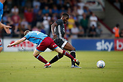Jordan Hallam Of Scunthorpe United challenges Kelechi Iheanacho of Leicester Cityduring the Pre-Season Friendly match between Scunthorpe United and Leicester City at Glanford Park, Scunthorpe, England on 16 July 2019.