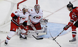 Apr 23, 2009; Newark, NJ, USA; A shot goes wide of Carolina Hurricanes goalie Cam Ward (30) during the third period of game five of the eastern conference quarterfinals of the 2009 Stanley Cup playoffs at the Prudential Center. The Devils beat the Hurricanes 1-0 to take a 3-2 lead in the best of 7 series.