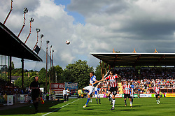 Eliot Richards of Bristol Rovers heads the ball and is challenged by Pat Baldwin of Exeter City - Photo mandatory by-line: Rogan Thomson/JMP - Tel: Mobile: 07966 386802 03/08/2013 - SPORT - FOOTBALL - St James Park - Exeter -  Exeter City v Bristol Rovers - Sky Bet League 2