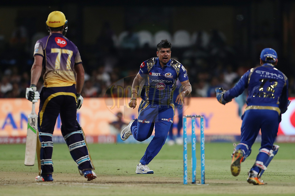 Karn Sharma of the Mumbai Indians celebrates the wicket of Colin de Grandhomme of the Kolkata Knight Riders during the 2nd qualifier match of the Vivo 2017 Indian Premier League between the Mumbai Indians and the Kolkata Knight Riders held at the M.Chinnaswamy Stadium in Bangalore, India on the 19th May 2017<br /> <br /> Photo by Ron Gaunt - Sportzpics - IPL