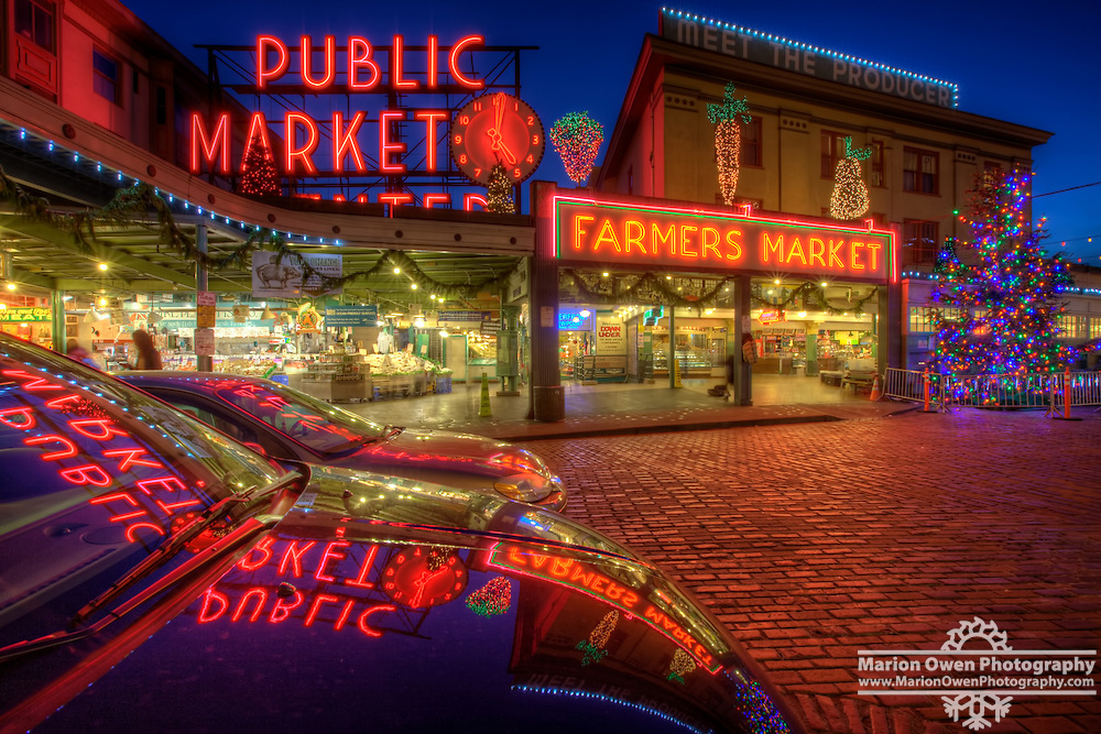 Seattle's Pike Place Market dressed up for Christmas with light reflecting in parked cars