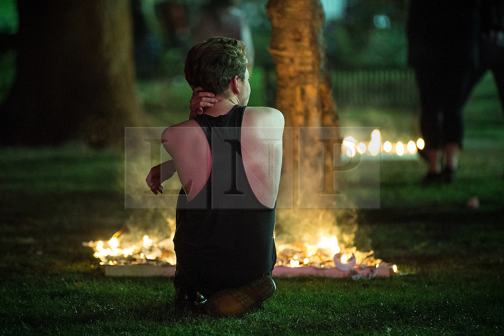 © Licensed to London News Pictures . 31/08/2015 . Manchester , UK . A candlelit vigil in memory of the victims of HIV and AIDS , in Sackville Gardens in Manchester's Gay Village , closes 2015 Manchester Pride . Photo credit : Joel Goodman/LNP
