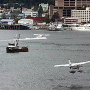 Amphibious planes land at the port  in Juneau, Alaska. <br /> Photography by Jose More