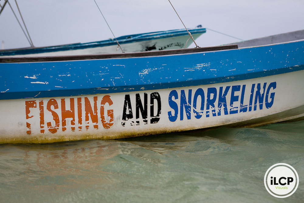 A local guide's boat on the beach in Puerto Morelos, Mexico. From a 2014 iLCP (International League of Conservation Photographers) expedition project documenting the people and places of the Mexican section of the Mesoamerican Reef (MAR).