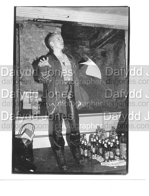 Kathy Acker, reading. Performance sponsored by Disobey Slaughterhouse Gallery, Smithfield, London 31st January 1997© Copyright Photograph by Dafydd Jones 66 Stockwell Park Rd. London SW9 0DA Tel 020 7733 0108 www.dafjones.com