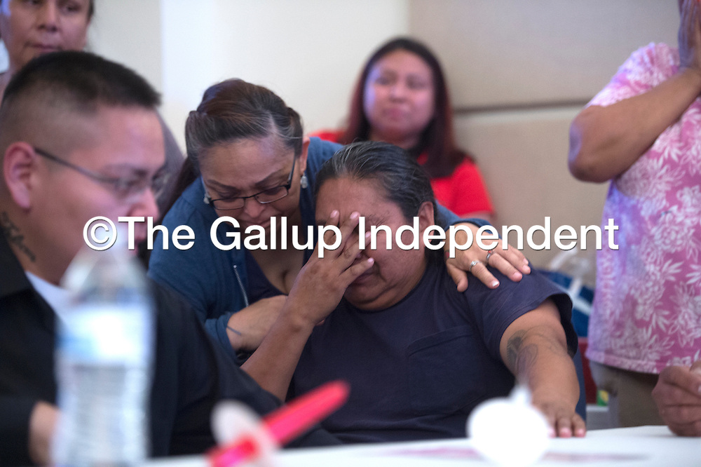 Gary Mike reacts to the news a suspect was taken in to police custody, Tuesday night, in connection to the murder of his daughter Ashlynne, during the memorial vigil in her honor at the San Juan chapter house in San Juan.