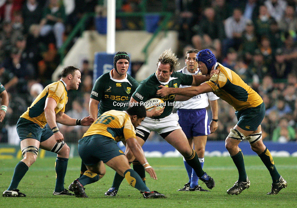 Jannie du Plessis with Heinrich Brussow is tackled by Nathan Sharpe and Tatafu Polota-Nau during the first 2009 tri-nations test match between South Africa and Australia held on the 8 August 2009 at Newlands Stadium in Cape Town, South Africa..Photo by RG/www.sportzpics.net.+27 (0) 21 785 6814